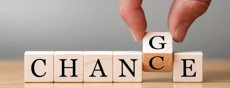 """Hand flip wooden cube with word """"change"""" to """"chance"""", Personal development and career growth or change yourself concept"""